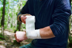 Applying an arm medical bandage Royalty Free Stock Image