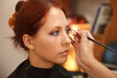 Applying art make-up Stock Image