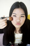 applying asian beautiful girl makeup Στοκ Φωτογραφίες