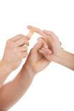 Applying a band-aid. Stock Photos