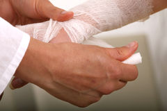 Applying bandage Royalty Free Stock Image