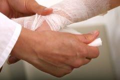 Applying bandage royalty free stock image