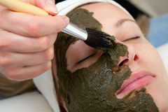Applying beauty mask Stock Images