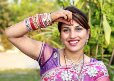 Applying bindi. Indian newly wedded girl applying bindi on her head Royalty Free Stock Photos