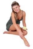 Applying body cream Royalty Free Stock Image