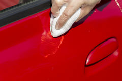 Applying car paints paste to the surface of the varnish. Distributing the polishing paste on the surface of the varnish Royalty Free Stock Photos
