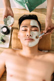 Applying clay facial mask Royalty Free Stock Image