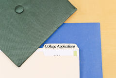 Applying For College. With Folders And Graduation Cap Royalty Free Stock Images