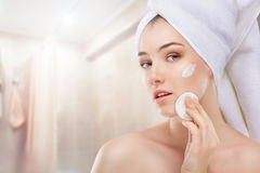Applying cosmetic cream Stock Images