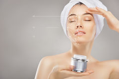 Applying cosmetic cream Stock Photography