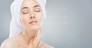 Applying cosmetic cream Royalty Free Stock Photos