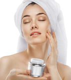 Applying cosmetic cream Royalty Free Stock Image