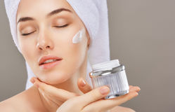 Applying cosmetic cream Royalty Free Stock Images