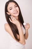 Applying cosmetic cream. A beautiful young woman applying face moisturizer. Scine care of the face and hands Royalty Free Stock Photography