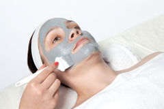 Applying cosmetic mask Royalty Free Stock Image