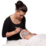 Applying cosmetic mask Stock Image