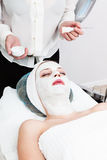Applying cosmetic mask Royalty Free Stock Images