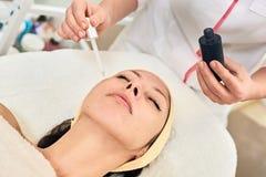 Applying Cosmetic Skin Serum Treatment Royalty Free Stock Photography