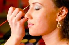 Applying cosmetics Royalty Free Stock Photography