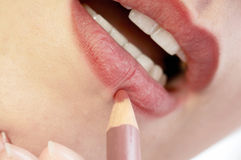 Applying cosmetics Stock Images