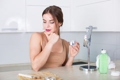 applying cosmetics woman Στοκ Εικόνες