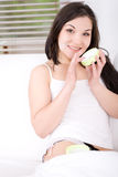 Applying cream Stock Photo
