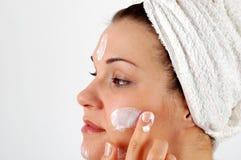 Applying cream #7 Stock Photos