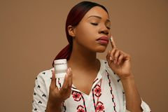 Applying cream every day on your face. Royalty Free Stock Photography