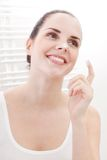 Applying cream on face skincare Stock Photos
