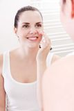Applying cream on face skincare Royalty Free Stock Photo