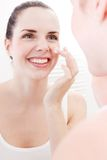 Applying cream on face skincare Royalty Free Stock Photos