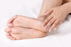 Applying cream to ankle Royalty Free Stock Photo