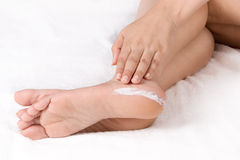 Applying Cream To Feet Royalty Free Stock Photo