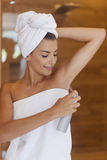 Applying deodorant Royalty Free Stock Photo