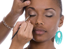 Applying eye-liner. Royalty Free Stock Photography