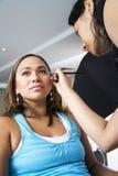 Applying eye liner. Make up artist applying eye liner stock photography