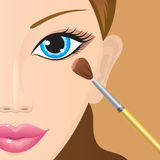 Applying eye-shadow Stock Image
