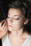 Applying eye shadow Stock Photography