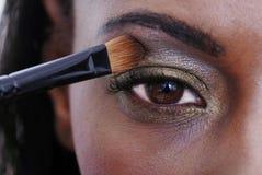 Applying Eye shadow stock images