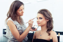 Applying eyebrow make-up Royalty Free Stock Photos