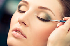 Applying Eyeliner Make-Up Royalty Free Stock Image
