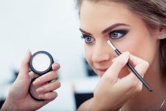 Applying eyeshadow Stock Photo