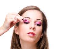 Applying eyeshadow Stock Image