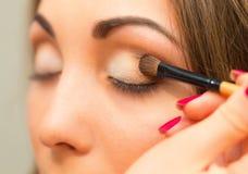 Applying eyeshadow on eyelid. Stock Photography