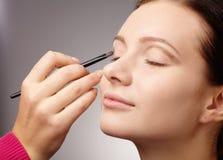 Applying eyeshadow for young girl Royalty Free Stock Photography