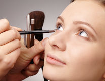 Applying eyeshadow for young girl Royalty Free Stock Images