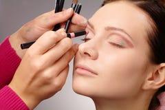 Applying eyeshadow for young girl Royalty Free Stock Image