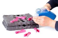 Applying fabric softener Stock Photo