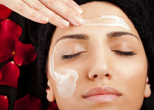 Applying face cream Royalty Free Stock Images