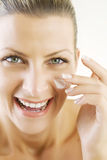 Applying face-cream Royalty Free Stock Photo
